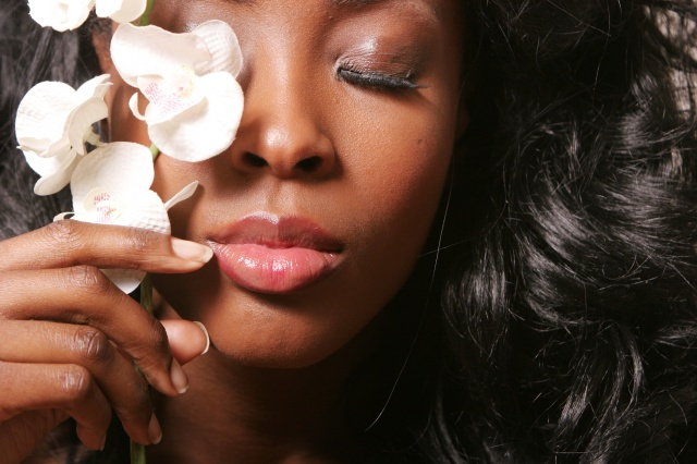 black woman with orchid